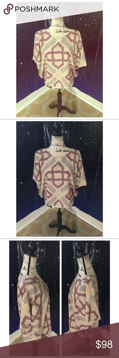 💜🔗Violet Link Janine Top💜🔗 Karen Zambos Violet Link Janine Top in size small. Loose fitting with bat wing sleeves. Made in the US. Karen Zambos Tops