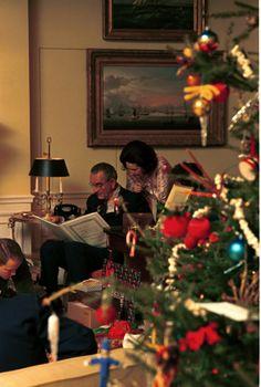 President Lyndon B. Johnson and Lady Bird Johnson looking at a book on Christmas Eve. 12/24/1967.