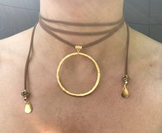 Wraparound brown suede chocker necklace with gold pendant and beads by AdornedBySuzie on Etsy https://www.etsy.com/listing/517873880/wraparound-brown-suede-chocker-necklace