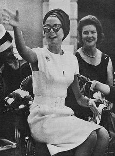 Grace's short sleeved white sheath, oversized sunnies and turban...sophistication personified.