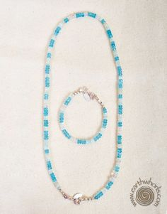 http://earthwhorls.com/product/blue-topaz-moonstone-and-sterling-silver-necklace/  Bracelet attaches to necklace to lengthen it!  One of a kind beautiful!