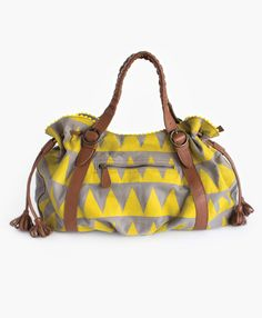 This fun geo-print bag features a classic mustard color. It's the perfect size for a weekender bag or for the girl who likes to carry everything but the kitchen sink with her! The interior features a beautiful blue geometric print lining for an unexpected pop of color.