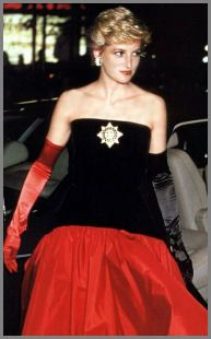 Designed by Murray Arbeid. Flamenco style ball gown with black velvet strapless bodice and red taffeta skirt. The Maltese Cross Order brooch made by Butler and Wilson of London. Diana wore this gown in 1986 to a London film premier and to the American Cup Ball. She also wore it in Spain in 1987. $25,300.00 Purchased by Suzanne King from Texas.