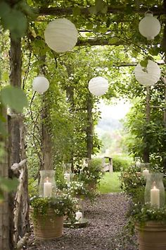 Arbor - lanterns. Absolutely love this. Great idea for the planned moon garden area of the yard.