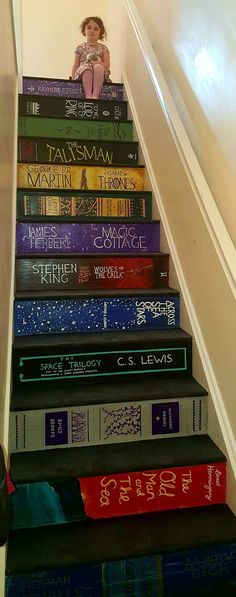 """DIY Book Stairs - the $26 Stair MakeoverYou can find more about Pippa Branham's DIY Book Stairs here, and see her post on FB here. From the Stair Artist Pippa Branham on Reddit here: """"First I painted the treads with black gloss with a little fine..."""