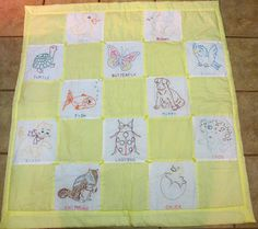 Vintage embroidered baby quilt
