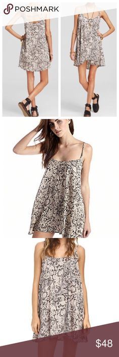 Free People printed Emily swing dress New with tags. Free People Emily printed swing dress by Free People in night combo as seen in pictures. Cute flowy fit perfect for summer layering or on its own as a sundress. Free People Dresses Mini