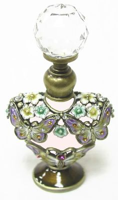 This stunning bottle deserves a solitary display..maybe in a glass dome?