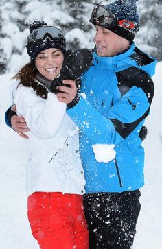 William and Kate show their playful side as they dance in the snow. Picture: John Stillwell/ AFP Pool / Getty Images