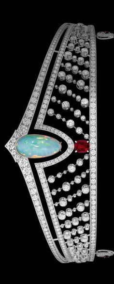 Art Deco Tiara in platinum, diamonds, set with a twenty-one carat cabochon-cut white opal, and a three carat Burmese pigeon's blood ruby. Pendants in platinum, diamonds, cultured pearls, and rubies. Chaumet, Paris.