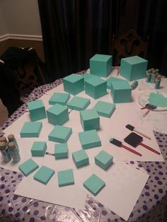 Pub crawl 2014-theme: Breakfast at Tiffany's. I am making center pieces for the VIP lounges we will be stopping at on our crawl. Guests will walk into already decorated rooms. Had to mix paint to perfect Tiffany and CO blue...