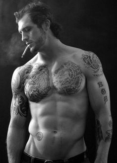 Something about men with tattoos and well maintained bodies...don't mind if I forget my name, while stare.