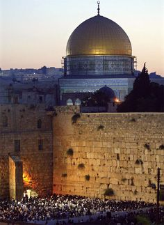 The golden Dome of the Rock shines in the background as Jews pray early at the Western Wall in Jerusalem's Old City to mark Tisha be-Av (July 27, 2004), which marks the destruction of the Temple, first in 587 B.C. and in A.D. 70.