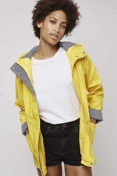 Stay cute whatever the weather throws at you with this hooded rain mac. Detailed with contrasting navy and white stripe detail to the hood and cuffs, it comes with a centre front zip fastening, patch pockets and a drawstring hood. #Topshop