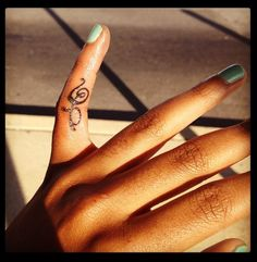 My finger tat. It means Hakuna Matata in Swahili