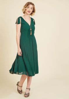 Ties to the Occasion Midi Dress in Pine | Mod Retro Vintage Dresses | ModCloth.com  Whether you're a bridesmaid, a party planner, or you simply desire elegant attire, your ideal ensemble can be found in this dark green dress. A ModCloth exclusive, this V-neck midi features pintucks at the tied shoulders and bodice, and is polished with a trumpeted hem - a gorgeous look for any event!