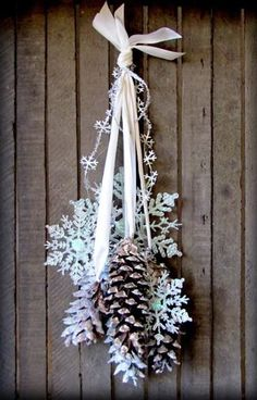 LOVE this glittered pinecone and snowflake door hanging! Perfect for Christmas and Winter decorations!