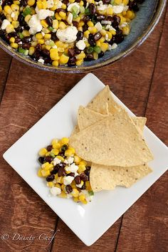 Black bean, corn, and feta dip. Eat this mess with Frito Scoops :-)
