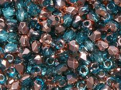 TRUE2™ 2mm Faceted Fire Polished Rounds Aqua Capri Gold from Nosek's Just Gems