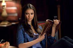 Elena (Nina Dobrev) reads on The Vampire Diaries.