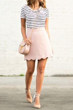 A blush pink scallop skirt is the ultimate summer item! Kim Le wears this cute piece with a horizontal striped tee and floral jewelry.