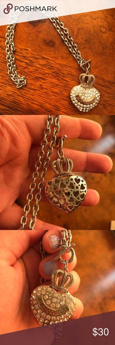 """Silver Juicy Couture Toggle Necklace A silver Juicy Couture necklace with a toggle closure. I've had it forever, but have never worn it. It has a puffed heart that says """"Juicy Couture"""" across the front with pretty diamond-like gems. Juicy Couture Jewelry Necklaces"""