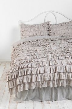 Waterfall Ruffle Duvet Cover. love this so much but my dog would tear it up in a day.