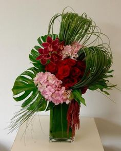 A Beverly Hills Florist presents this design featuring a dozen Red Roses with Cymbidium Orchids, accompanied by beautiful Pink Hydrangeas and Greens in a Leafed Vase. This lavish design makes an excellent gift for many occasions, including your Anniversary, an important Birthday or as a simple Thank You.24