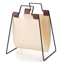 """Get organized with the Collapsible Magazine Holder!Store more than just magazines; place mail, books, and more items that are lying around the room. Stay organized in style!FEATURES• Metal frame and canvas holder with faux-leather accents• 9.25"""" x 8.75"""" x 13.75""""• Black metal frame with handles at top• Off-white canvas with brown straps connecting to frame at topMATERIALS• Metal• Canvas• Faux-leather accentsCARE• Wipe clean with a damp clothSome a..."""
