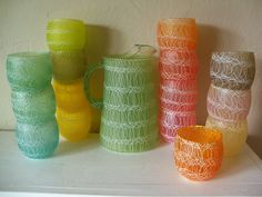 Swirly glass roly poly cups and pitcher. We had these when I was growing up!