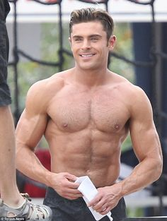 Smouldering! That same day Zac Efron went shirtless and showed off his rock hard abs and b...