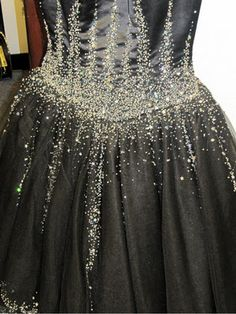 A little black dress in always in style, this one may have a little too much bling.