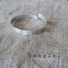 """come as you are""....    s i e b e n w e l l e n    bangle. sterling-silver, poetry stamped,"
