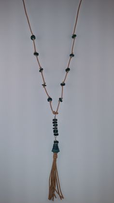 """Natural Tan Leather Tassel Necklace    30"""" in Length    Teal Wooden Beads & Metal Cone Accents    6"""" Pendant/Tassel   Shop this product here: http://spreesy.com/classygalcreations/87   Shop all of our products at http://spreesy.com/classygalcreations      Pinterest selling powered by Spreesy.com"""