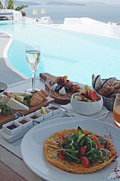 Breakfast, brunch, lunch in Santorini Greece overlooking infinity luxury pool at hotel in Santorini Greece