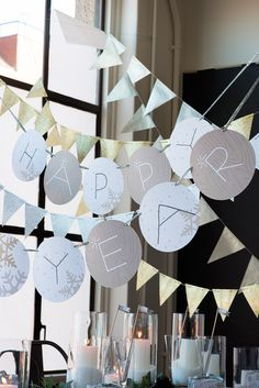 Silver and Gold NYE Party Garland by Minted.   @Lisa Ganson Trujillo we can get scrapbooking paper + pretty ribbon and make this ourselves! (Or buy this one, lol).