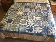 """This is my """"Winding With William"""" quilt, finished in 2012. Winding Ways block pattern, using William Morris - inspired fabrics. Machine pieced and hand and machine quilted. Used a Curvemaster foot on my sewing machine to do the curved piecing, made it a lot easier!"""