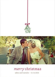 Kiss your bride under the mistletoe this Christmas! Share your first Holiday as newlyweds with customizable photo cards by Minted. Shop Mistletoe Kiss Holiday Petite Card by roxy and many more designs today at minted.com