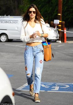 Stylish streetwear: Alessandra Ambrosio went to breakfast in Brentwood, California on Wednesday in boyfriend jeans, a cropped sweater, and leopard print slip-on shoes