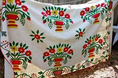 """Antique Quilt English Flower Garden Circa 1860 Orig Design Urn of Flowers   eBay seller simclees, hand appliqued, 19"""" blocks, 6.5"""" sashing, 7"""" border on three sides, touches of embroidery; red, straight grain binding hand stitched front & back with round corners, imprint of feedsack on one of back panels showing clasped, shaking hands and words """"Union Shirting."""""""
