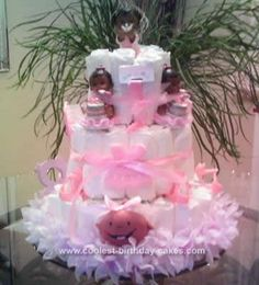 Homemade Pink Angel Diaper Cake... This website is the Pinterest of diaper cake ideas