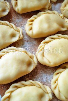 Pierogi z ziemniakami, serem feta z rozmarynowym masłem