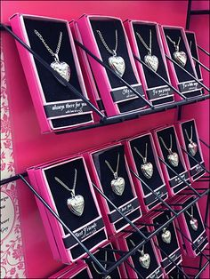 Wide, single wireform ledges are custom subdivided into multiple facings for massed display of fashion jewelry. Heart Lockets might always be popular, but these are custom engraved with a range of … Slat Wall, Heart Locket, Lockets, Custom Engraving, Trays, Fashion Jewelry, Retail, Range, Display