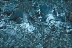 August 1994 near-vertical aerial photograph of part of the surface of the Bering Glacier showing a number of tightly folded and contorted crevasses. Field of view is ~1/8 mile