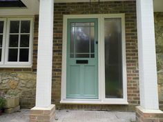 English Door Company installation. Chartwell Green door with large midrail, town lock and wrought iron letterbox.