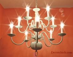 An $8 thrift store chandelier makeover. Spray painted in Aqua. decorchick.com