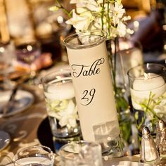 translucent paper over candle holders for table numbers