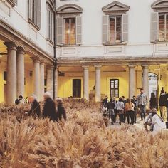 """The scenic courtyard of the Baroque-style Palazzo Litta has been transformed into a """"neo-African village"""" by Berlin-based architect Diébédo Francis Kéré. Photograph is by @white_interiors49 #milanogram2016 by dezeen"""