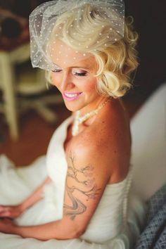 Vintage polka dot birdcage veil, soft curls, and light pink lips | Photo by Jason Mize via http://junebugweddings.com/wedding-blog/geometric-inspired-wedding-selby-gardens/