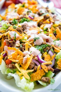 This Easy Classic Taco Salad is easy to make and perfect for an easy meal or side dish - make it in under 30 minutes for a summer barbecue or a quick weeknight dinner! Recipe from thebusybaker.ca! #taco #tacosalad #tacotuesday #sidedish #summer #barbecue #potluck #mexican #texmex #easyrecipe #familymeal #weeknightmeal